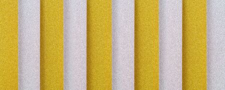 golden and silver vertically  striped textured background with plastic 3d effect