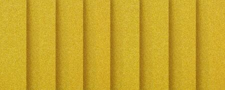 golden vertically  striped textured background with plastic 3d effect