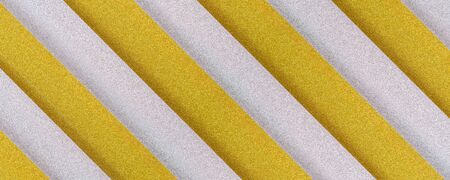 golden and silver diagonaly  striped textured background with plastic 3d effect