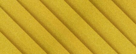 golden diagonaly  striped textured background with plastic 3d effect Фото со стока