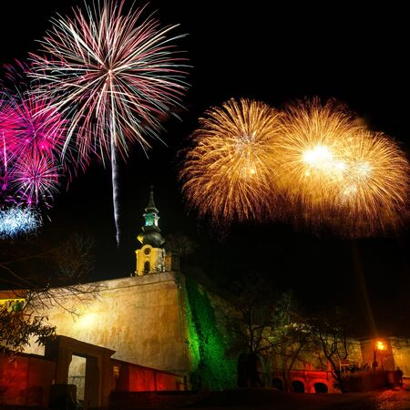 twilight view of lit Nitra castle with dramatic night skyline and firework parade during new years night