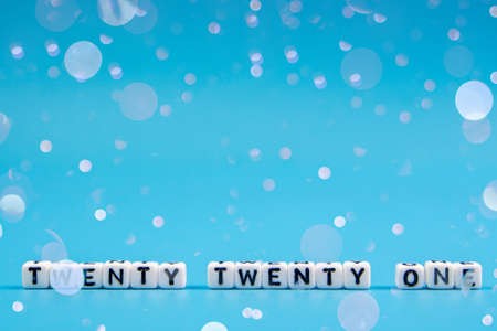 2021 happy new year dice word text on blue background, leave space for display of product for promotion on christmas and new year with plenty copy space