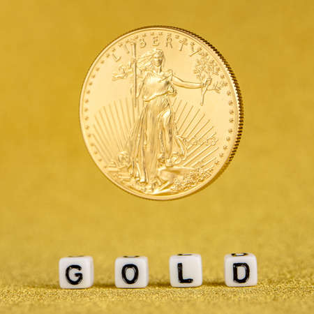 golden american eagle one ounce coin levitating on the letters gold made of white dices with golden background