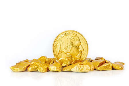golden american buffalo one ounce coin laying on a heap of golden nuggets, golden ore on white background isolated with plenty copy space