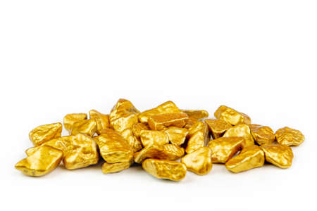 view of a heap of golden nuggets, golden ore on white background isolated with plenty copy space