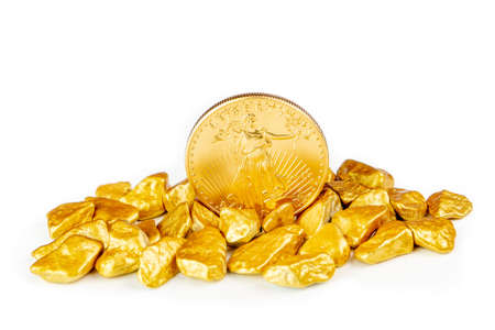 golden american eagle one ounce coin laying on a heap of golden nuggets, golden ore on white background isolated with plenty copy space Stock Photo - 155220888