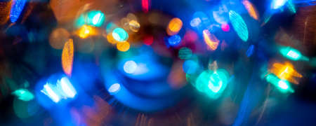 vibrant color blurred celebration dancing night lights in the city life may be used as party, birthday, christmas or night city life themed background