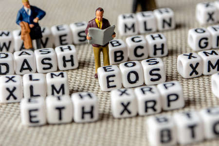 set of popular crypto coins forming rows made of white cubes with black capital letters and miniature businessmen figurines having a team meeting, bitcoin, altcoins, ethereum, ripple, lumen, eos, litecoin, omisego, monero