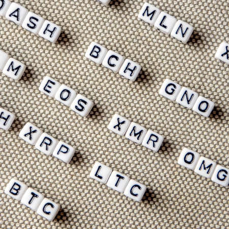 set of popular crypto coins forming rows made of cubes with capital letters, bitcoin, altcoins, ethereum, ripple, lumen, eos, litecoin, omisego, monero
