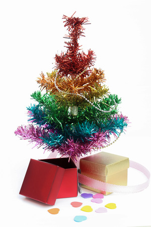 Bright and colorful studio shot of a Christmas tree with gift boxes photo