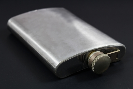 hip flask: Stainless hip flask on black  Stock Photo