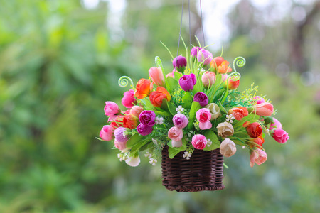 hanging flowers in a vase, hanging on a rope photo