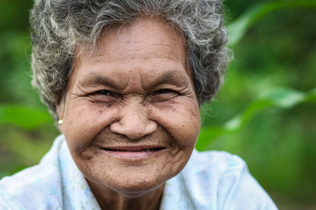 old asian woman smiling  photo