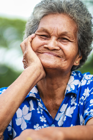 old asian woman smiling. photo