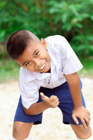 Portrait of Thai school boy in uniform.