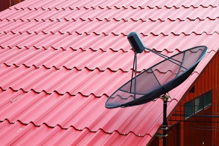 Satellite dish on the red roof Stock Photo - 14363475