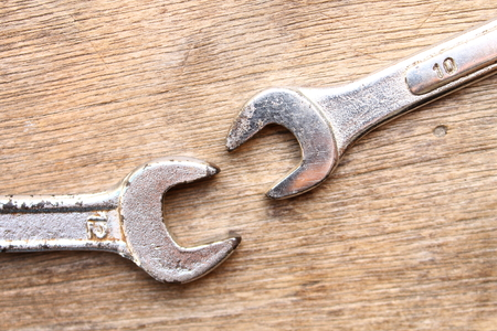 wrench on wood background