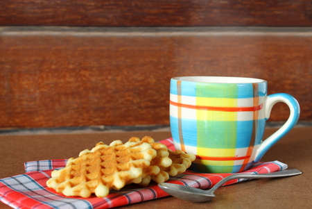Hot cup of coffee on sack with waffle Stock Photo