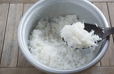 Jasmine rice cooking in electric steam