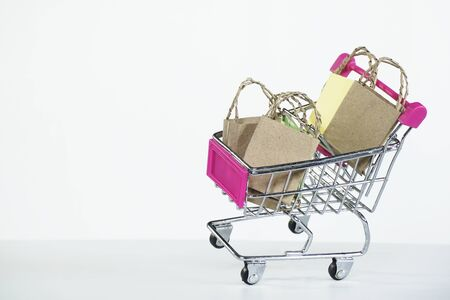 shopping cart and shopping bags on white background black friday sale shopping