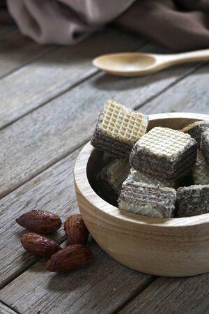 Milk chocolate flavored wafers on old wooden floors Standard-Bild