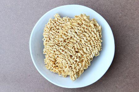 Instant noodles in a bowl Standard-Bild