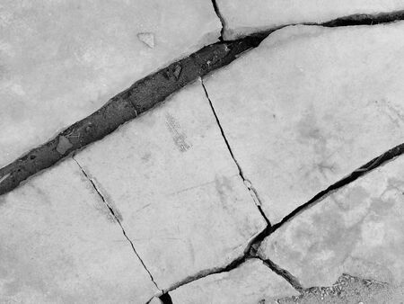 crack on the wall with black and white concept