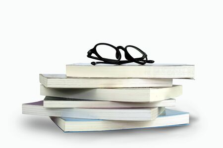 Books and reading glasses on a white background