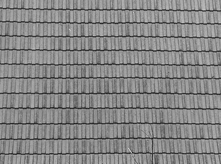 Black and white roof  tiles on the texture background