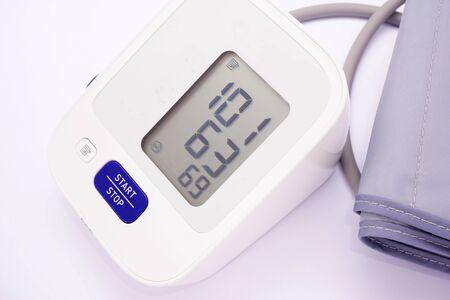 Blood pressure monitor on white background Standard-Bild