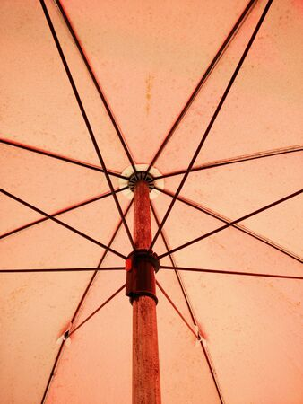 close up umbrella on a red background