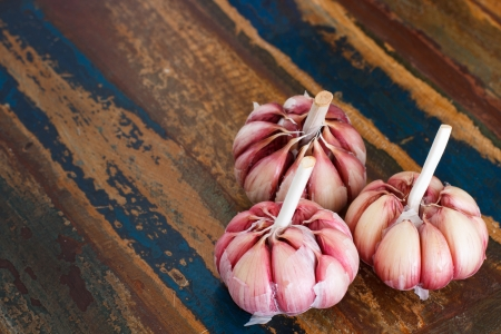 Garlic on wooden table  photo