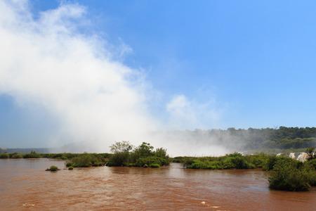 clouds making: Waterfall Iguazu falls making clouds close, Argentina, Brazil