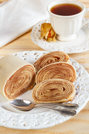 Brazilian dessert Bolo de rolo  swiss roll, rollcake  cup of tea  Selective focus photo