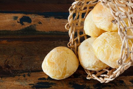 Brazilian snack cheese bread  pao de queijo  in wicker basket  Selective focus  Copy space