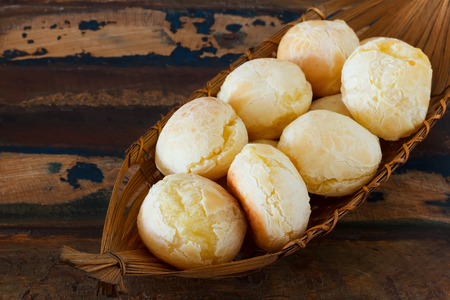 Brazilian snack pao de queijo   cheese bread  in wicker basket Archivio Fotografico