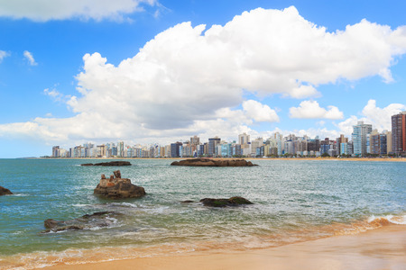 Beach Praia da Costa, sea, blue sky, buildings, Vila Velha, Espirito Santo, Brazil 免版税图像