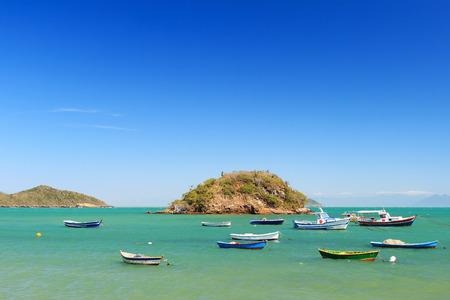 armacao: Boats, yachts trip island transparent turquoise blue sea in Armacao dos Buzios, Rio de Janeiro, Brazil Stock Photo