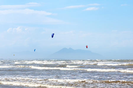 rasa: Background: Kitesurfing on beach Rasa in Armacao dos Buzios near Rio de Janeiro, sea, waves, Brazil. Selective focus Stock Photo