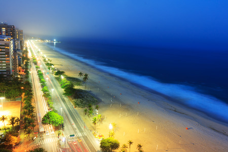 seafront: Night view of Ipanema beach after sunset, sea with fog from the sea on the background, Rio de Janeiro, Brazil