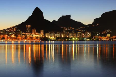 brazil beach: Sunset Lagoon Rodrigo de Freitas (Lagoa), mountain Two brothers, Stone of Gavea, Rio de Janeiro, Brazil