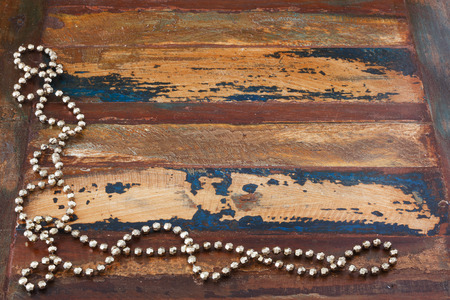 chaplet: Background wooden table with christmas chaplet. Copy space Stock Photo