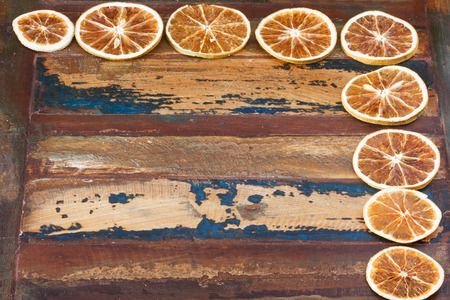 dried orange: Background wooden table with  slices of dried orange. Copy space