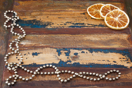 dried orange: Background wooden table with christmas chaplet and  pieces of dried orange. Copy space