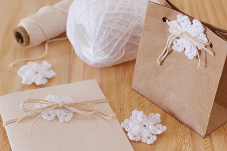 sewing box: White crochet snowflakes for Christmas decoration of greerings card and box. Selective focus Stock Photo