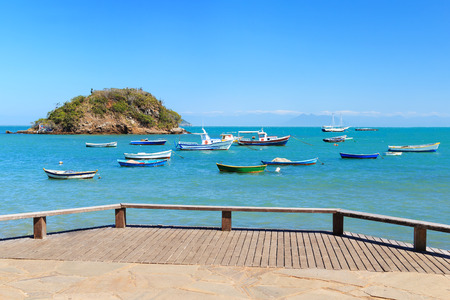 armacao: Embankment with view of Boats, yachts trip island transparent turquoise blue sea in Armacao dos Buzios, Rio de Janeiro, Brazil