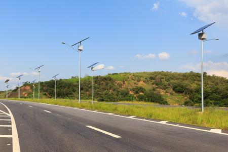 Solar modules panel on electric pole, use of Solar energy for lightning of highway, Rio de Janeiro, Brazil Archivio Fotografico