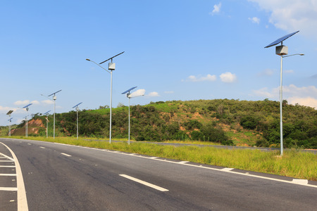 lamp post: Solar modules panel on electric pole, use of Solar energy for lightning of highway, Rio de Janeiro, Brazil Stock Photo
