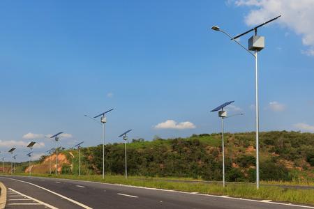 Solar modules panel on electric pole on highway, use of Solar energy for lightning, Rio de Janeiro, Brazil Archivio Fotografico