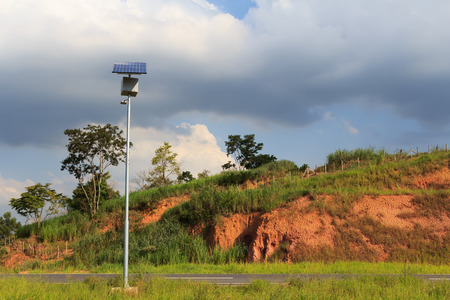photoelectric: Solar panel on electric pole on road  for lightning in countryside, use of Solar energy, Rio de Janeiro, Brazil